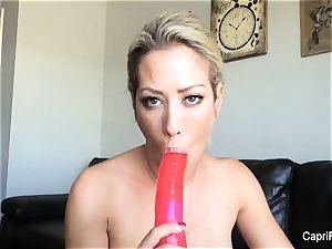 Capri plays with her phat fake penis