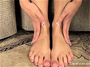 spectacular Capri Cavanni plays with her ultra-cute feet