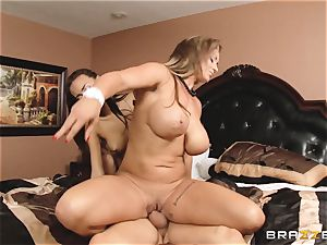 Eva Notty demonstrates her stepdaughter Janice Griffith how to please a schlong